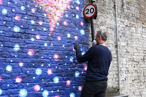 Jimmy C working on his artwork in Southwark