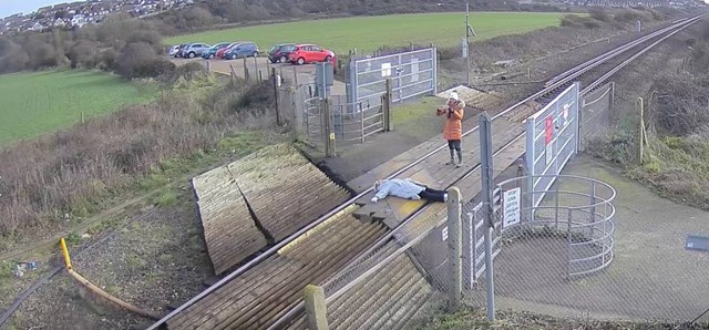 Network Rail is urging people to stay safe at level crossings after shocking CCTV footage showed a woman laying on railway tracks to pose for photographs: Misuse at Tidemills level crossing