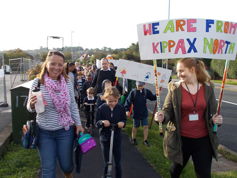 Kippax pupils put their best foot forward for car free day: childrenwalkingwithbanners.jpg
