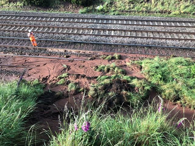 Engineer assessing the landslip near Whitmore, Staffordshire
