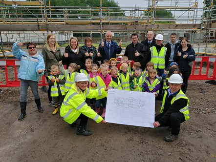 Pilmuir Nursery children give new building thumbs up: Pilmuir Nursery Children and parents see the plans for their new nursery on site