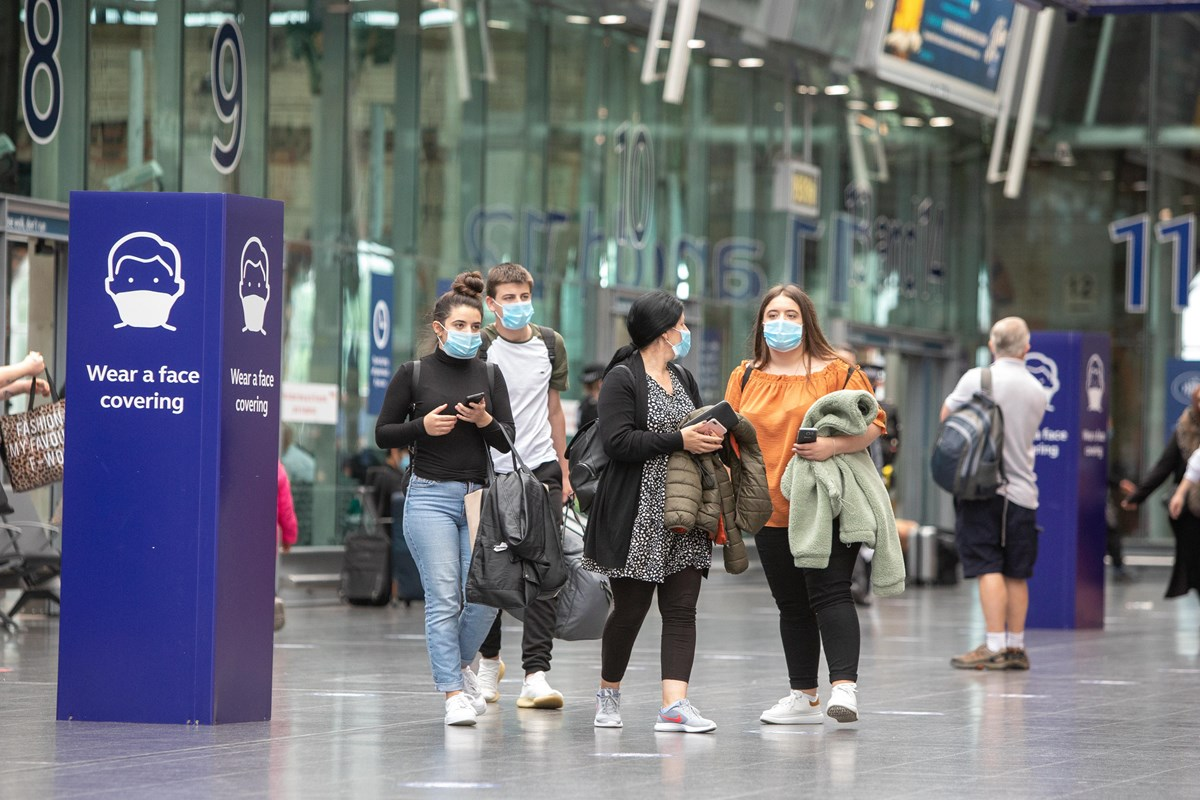 People wearing face coverings at Manchester Piccadilly station: Credit: Network Rail