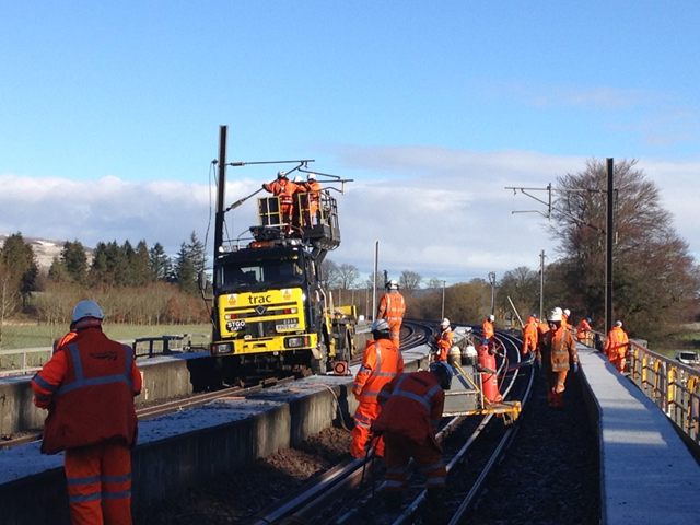 Lamington Viaduct track prep works: Network Rail engineers working on track and overhead power lines as Lamington Viaduct recovery enters final week.