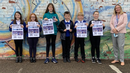 New Elgin Primary's Digital Leaders (L-R: Lucia, Cembra, Zara, Tyler, Mitchell and Marley) with Head Teacher, Elaine Milne