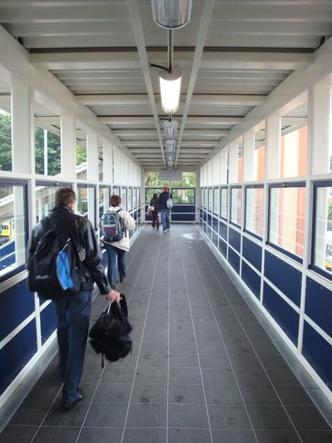 Passengers using new footbridge
