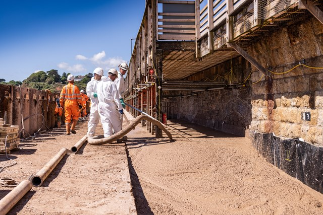 Pouring the low carbon concrete as part of the construction of the sea wall