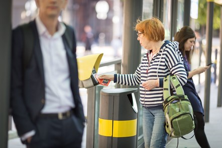 Contactless Metrolink - woman touching smart reader with card