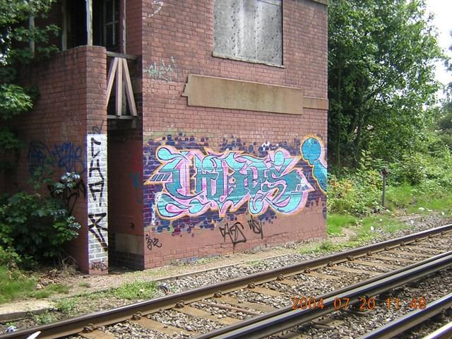 Graffiti vandalism on signal box - Chiswick, West London: Vandalism on a disused signal box in Chiswick, West London. Photo taken May 2006.