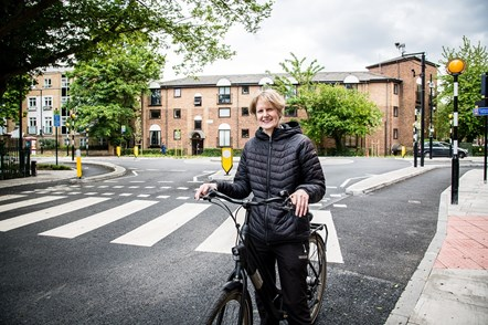 Cllr Champion on her bike by the new continental-style roundabout