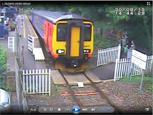 Matlock Bath - Gates lodged open while a train goes over the crossing
