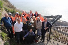 Dover - Shakespeare Beach: Network Rail, Costain and Kent County Council, MP Charlie Elphicke, Channel Swimmers, dog walkers and their dogs celebrate the opening of Shakespeare Beach and the new footbridge to it in Dover