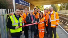 Sir Peter Hendy, Chairman of Network Rail, is joined by Stuart Kistruck, Network Rail's Route Managing Director, as wells as representatives from South West Trains and members of the project team to officially mark the opening of the new, longer platforms at Martins Heron station. Also photographed are: Dave Josey, South West Trains station manager; Tatiana Kotrikova, Network Rail scheme project manager; Adam Piddington, deputy customer service director, South West Trains; Zen Nichols, senior programme manager, Network Rail