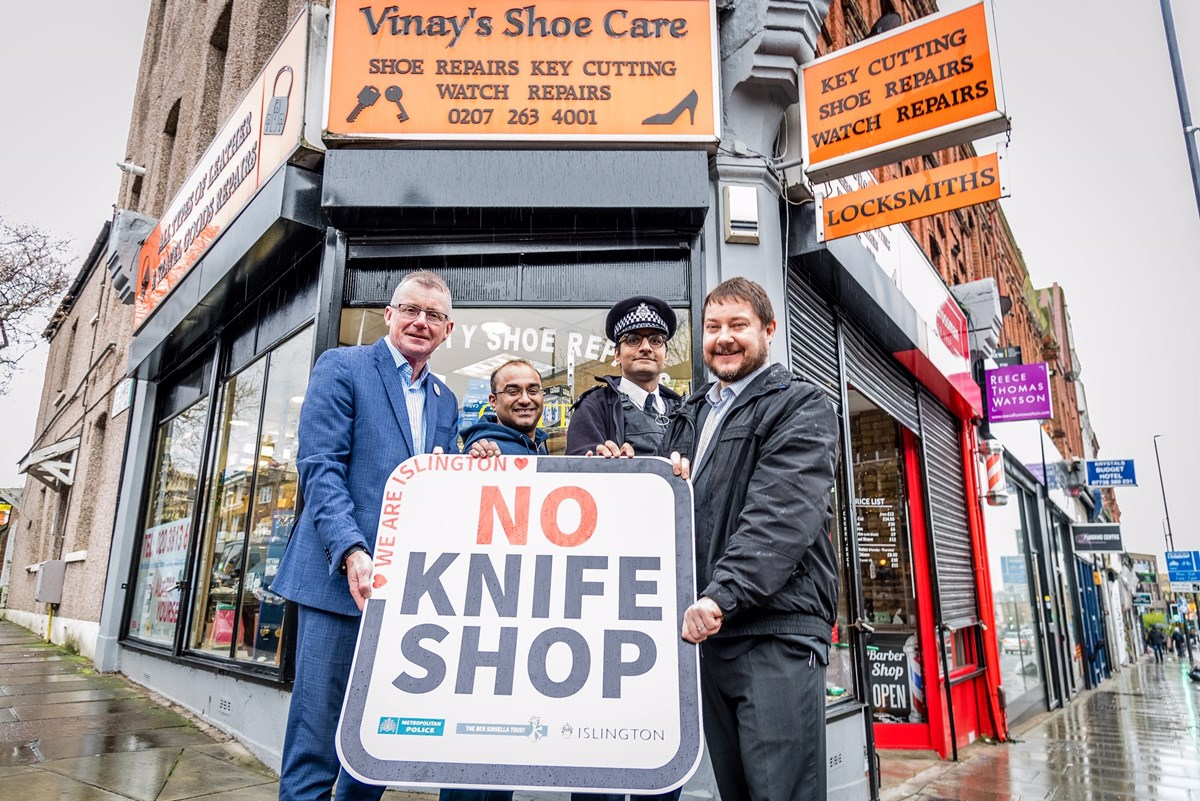 Islington No Knife Shop 1: L - R: Patrick Green (CEO, Ben Kinsella Trust),  Vinay Chohan (Owner, Vinay's Shoe Care), Constable Razwan Hussain (Metropolitan Police), Cllr Andy Hull (Islington Council)