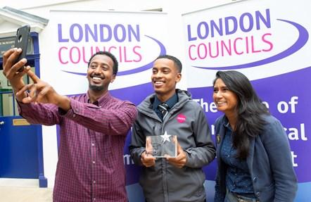 Usama Mohamed - London Borough Apprenticeship Awards 1: Usama Mohamed, centre, celebrates with Zak Hassan, a mentor at Jubba Youth Community Association, left, and Darshna Dhokia, Islington Council's youth employment and apprenticeships manager