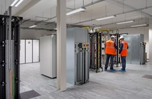 Engineers installing IT equipment which will help power the Manchester Rail Operating Centre (ROC)