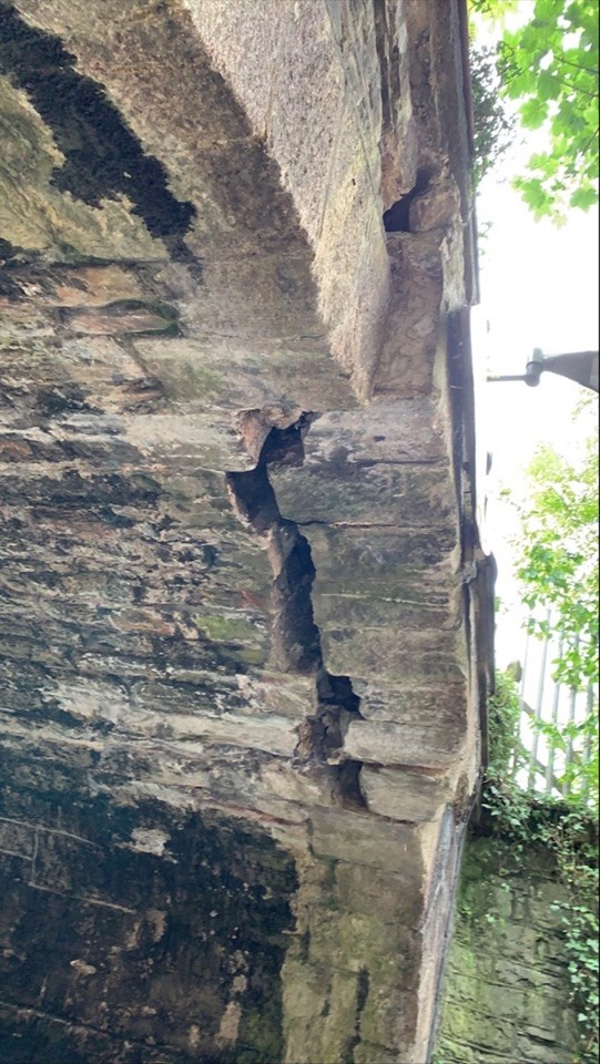 Huge cracks have appeared following the bridge being hit by a lorry