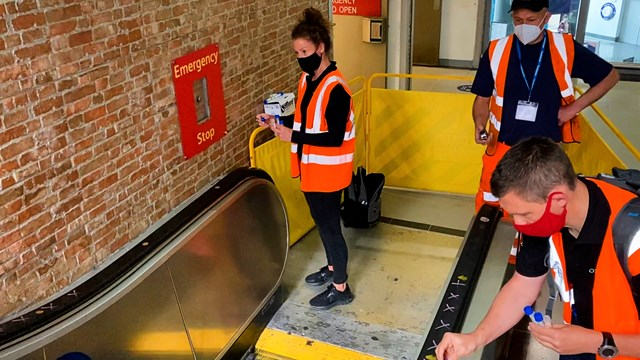 Teams analysing the effectiveness of the OXONOX escalator sanitising system at Manchester Piccadilly