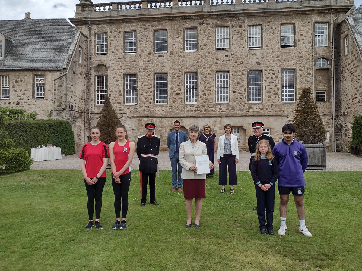 Pupils from Elgin Academy and Gordonstoun launch the Moray Badge Platinum Jubilee with Lords-Lieutenant of Moray and Banffshire; Deputy Lieutenant Joanna Grant Peterkin (Chair of the Moray Badge Platinum Jubilee); Elgin Academy Head Teacher, Kyle Scott; Principal of Gordonstoun, Lisa Kerr; and Convener of Moray Council, Cllr Shona Morrison