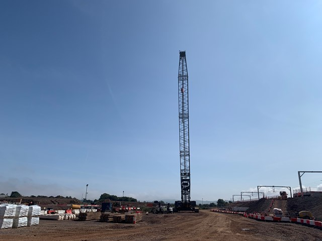 Crane is lifting concrete platform sections into position