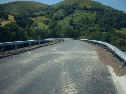 Approach road constructed to serve new bridge