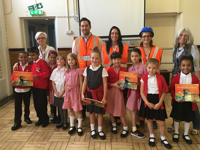 Children's Brazilian-style pictures show how they will benefit from electric railway: Children at Mission Grove Primary School receive railway safety talk