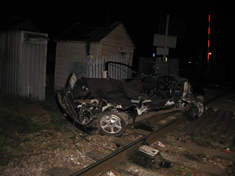 Remains of car after smash with train at Sandhill level crossing near Cambridge