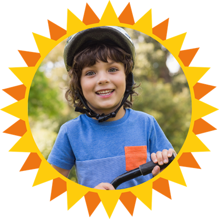 Heatwave 2020 image showing a child in a cycle helmet