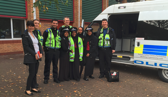 Rail industry is working together to remind people in Wales and the borders to stay safe: Cardiff Councillor Sarah Merry, BTP officers and Fitzalan High School pupils learning about level crossing safety during Rail Safety Week 2017