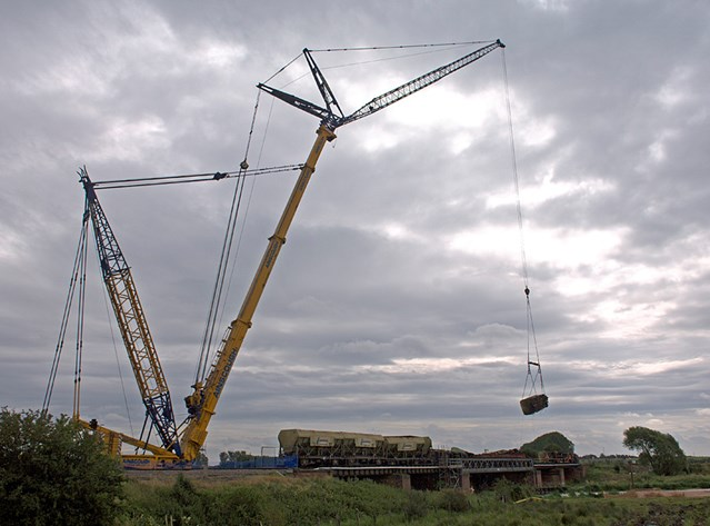 FREIGHT WAGONS LIFTED FROM ELY RAIL BRIDGE : Wagons are lifted from the damaged Ely rail bridge