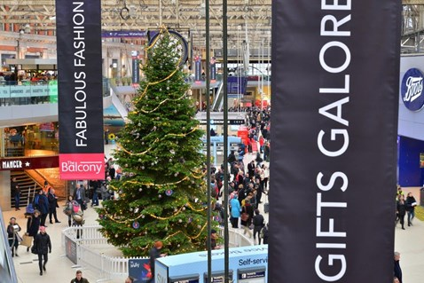 Waterloo railway station with Christmas tree and banners