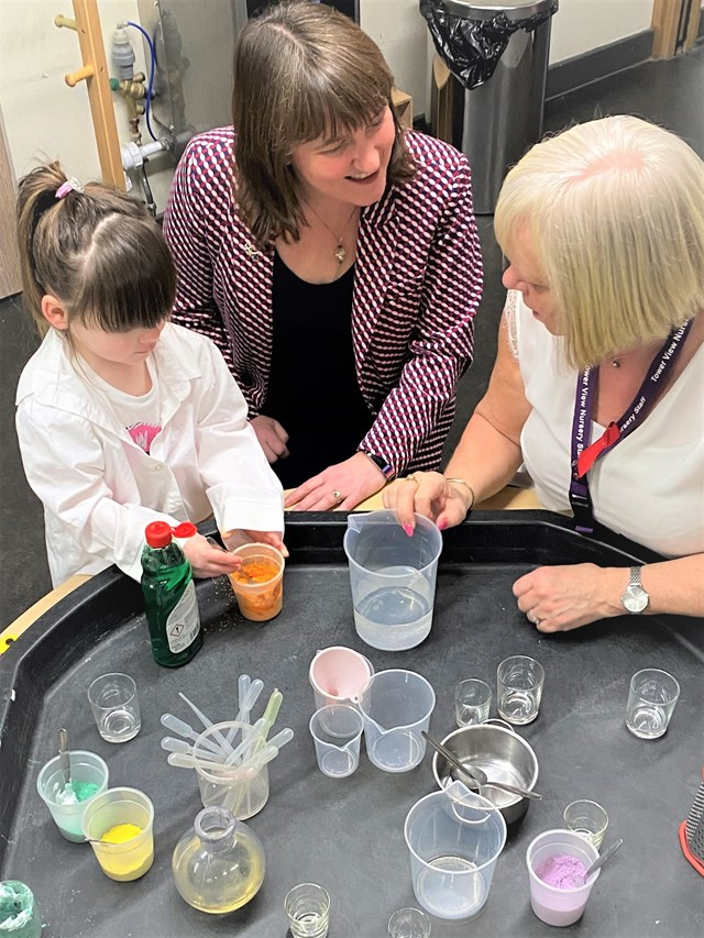 Early Learning and Childcare Expansion Programme: Children's Minister Maree Todd takes part in a science lesson with a child and member of staff at Tower View Nursery in Glasgow