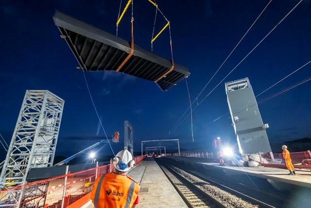 Reston Station footbridge installation: Main footbridge span being craned into position over the East Coast Mainline