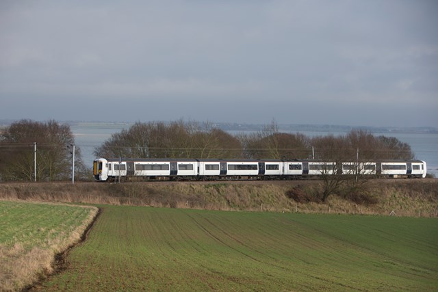 Battery-powered train (IPEMU) cutting through Essex countryside: The new train contributes to Network Rail's commitment to reduce its environmental impact, improve sustainability and reduce the cost of running the railway by 20 per cent over the next five years. It could ultimately lead to a fleet of battery-powered trains running on Britain's rail network which are quieter and more efficient than diesel-powered trains, making them better for passengers and the environment. Network Rail and its industry partners – including Bombardier, Abellio Greater Anglia, FutureRailway and the Rail Executive arm of the Department for Transport (which is co-funding the project) – recognise the potential for battery-powered trains to bridge gaps between electrified parts of the network and to run on branch lines where it would be too expensive to install overhead electrification.