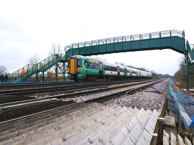 Dean Farm Train: A train to London rushes under the new bridge at 90mph, and over the old crossing