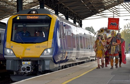 Chester 3: The soldiers of Roman Tours Deva Victrix walk in Northern's new train at Chester station