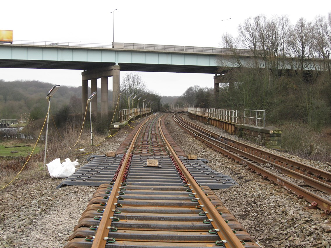 Gathurst - Appley Bridge improvement work: New rail on steel sleepers on approach to Gathurst Viaduct in the shadow of M6 motorway