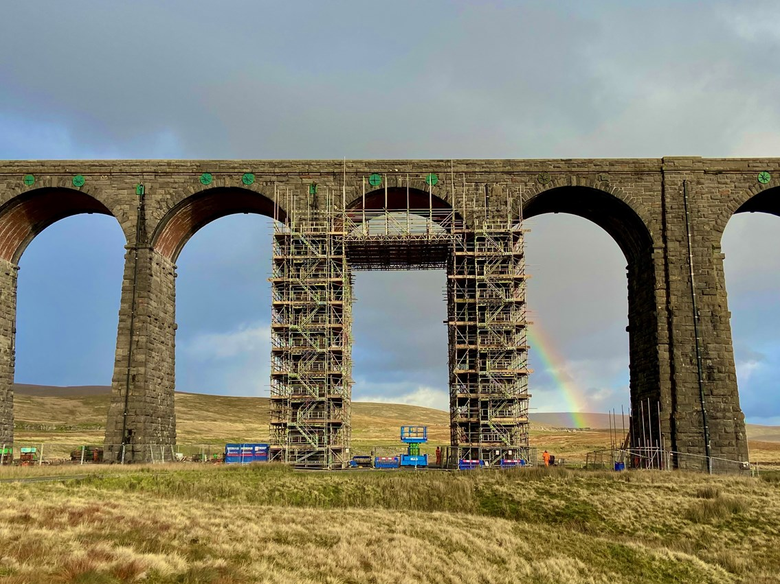 Ribblehead viaduct with rainbow in background