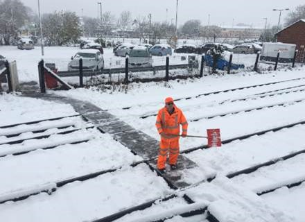 Mobile operations manager clearing a walkway in Wales (December 2017): winter, extreme weather