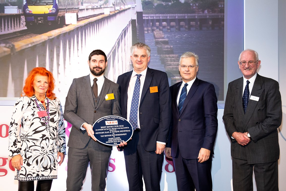 Tay Bridge claims top prize at railway heritage awards: Tay Bridge - Mark Wilson of Network Rail (2nd left) and Jason Worrall of Taziker (centre) with Lady McAlpine, Mark Carne, former Network Rail CEO and John Ellis of the NRHA