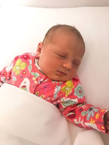 Man delivers baby in family sitting room: Baby Faith