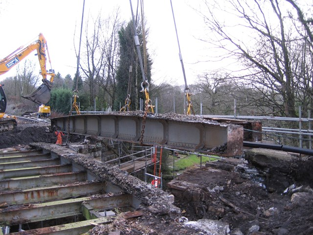 King William IV bridge: Having been cut up, old bridge girders are lifted out from the bridge.