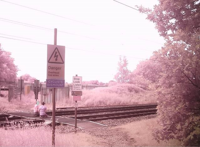 Doncaster parents urged to speak to children about dangers of trespassing on the railway amid school closures: Pedestrians sitting on level crossing in Doncaster