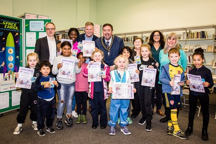 Children celebrate the completion of the 2019 Summer Reading Challenge, with Islington Councillors Richard Watts, Diarmaid Ward, Troy Gallagher, Marian Spall, Asima Shaikh and Tricia Clarke.: Children celebrate the completion of the 2019 Summer Reading Challenge, with Islington Councillors Richard Watts, Diarmaid Ward, Troy Gallagher, Marian Spall, Asima Shaikh and Tricia Clarke.
