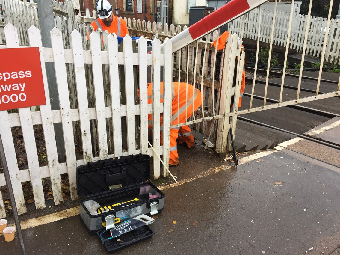 Network Rail engineers fixing the level crossing barrier at Hartlebury