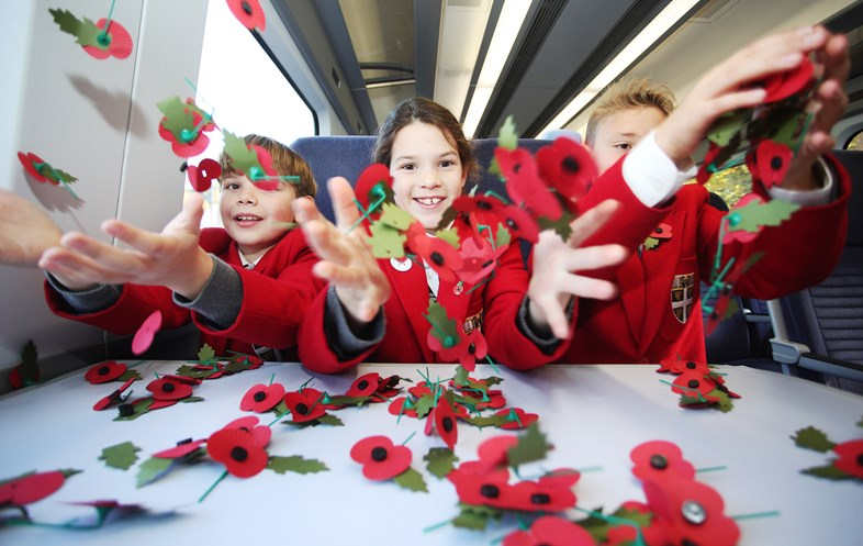 High Speed WW1 History Lesson For Pupils On-Board Poppy Train: Pupils from Dover College Junior School learn the inspiration behind the poppy as a symbol of remembrance on board Southeastern's High Speed Poppy Train v2