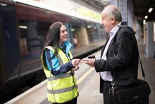 Female colleague Emily, Platform staff helping passenger at Tunbridge Wells station