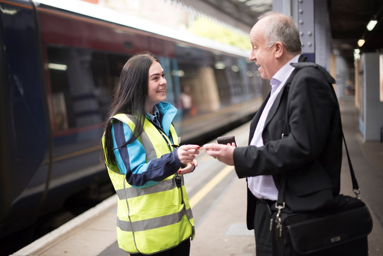 Southeastern achieves significant improvement in passenger satisfaction: Female colleague Emily, Platform staff helping passenger at Tunbridge Wells station