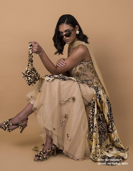 Lookbook p18: Jordan Mitchell models a dress, bag and jewellery in one of the images from the #FRFV lookbook.