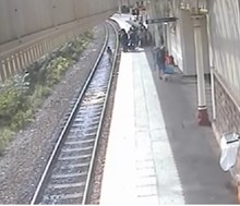 Young person trespassing on the track at Halifax station