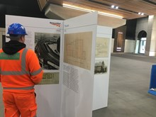 Construction worker LB: A construction worker reads about the history of London Bridge station